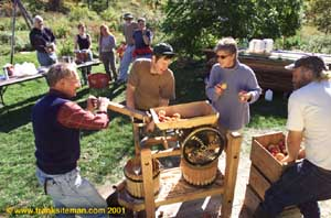 Michael Phillips and friends pressing cider from organic apples at Lost Nation Orchard at Heartsong Farm -- photo: Frank Siteman